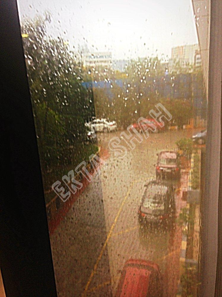 Parking view from window in Rain